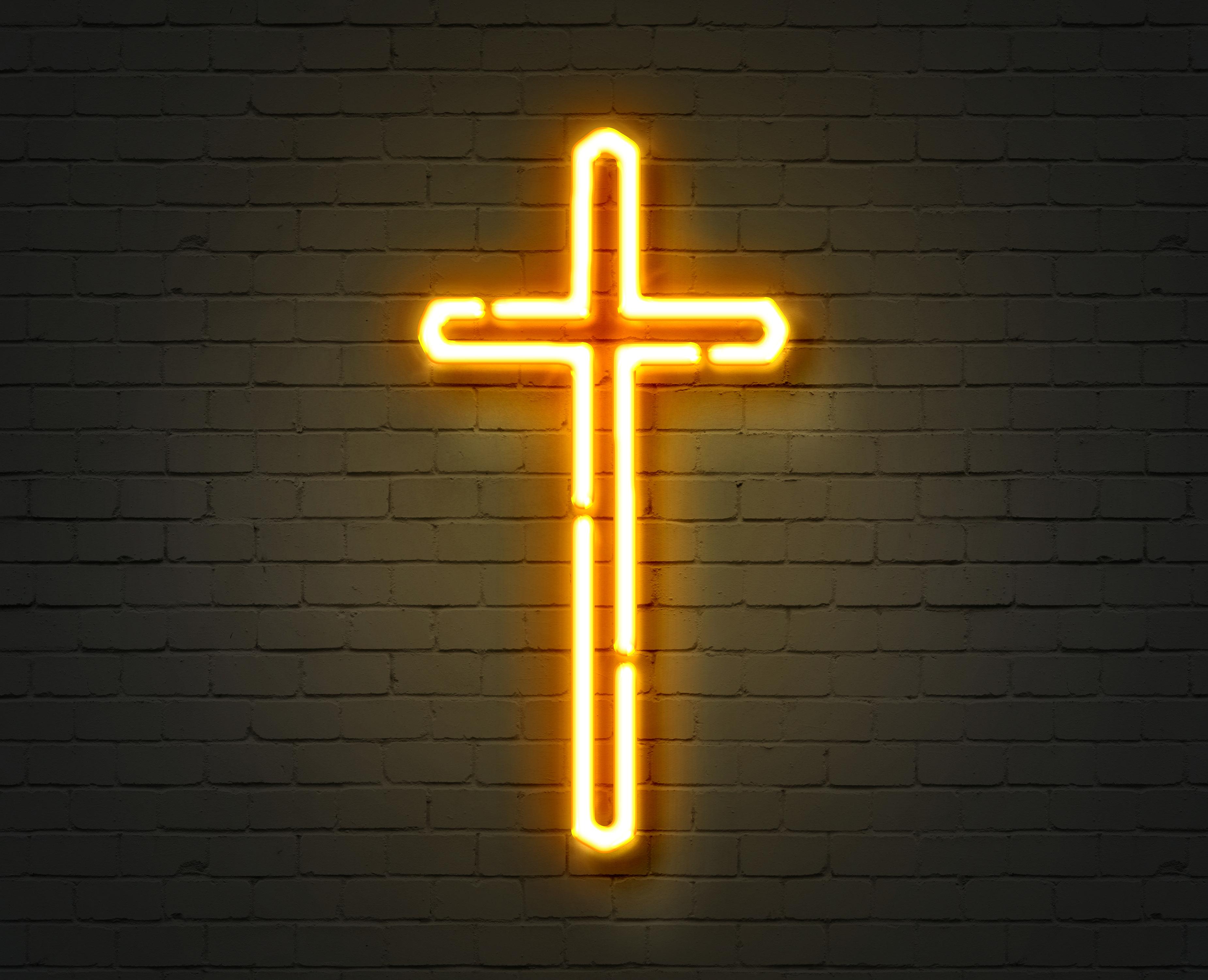Yellow neon cross. Sign of Christianity jesus