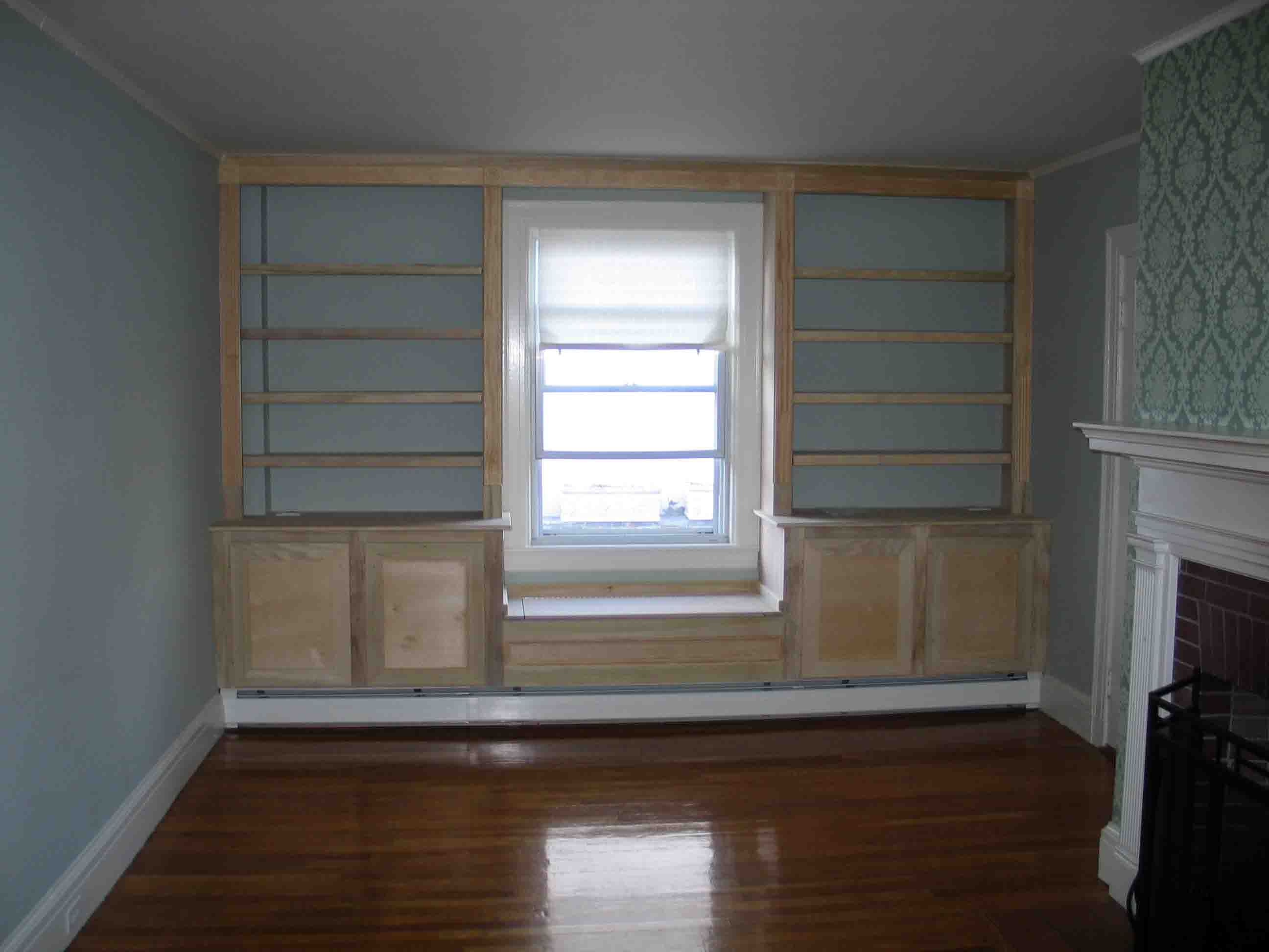 built in bookcase around window and heater this unit includes recessed lighting in the on kitchen cabinets around window id=13819