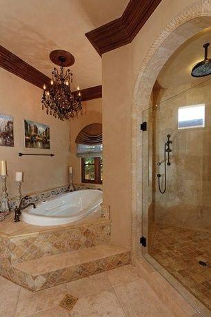 mediterranean master bathroom with daltile fidenza dorado
