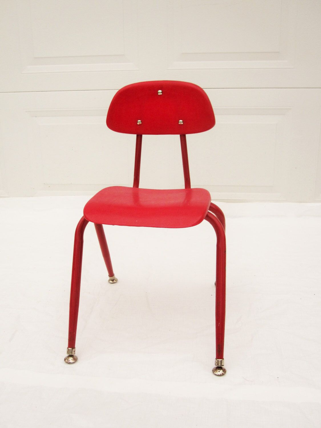 Molded plastic and metal chairs - A Red Plastic Chair For A Child Molded Plastic And Metal Chair Sturdy
