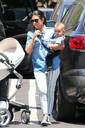 Kourtney Kardashian wearing Joe's Jeans Striped Skinny Jeans and Converse Chuck Taylor All Star Core Hi Sneakers