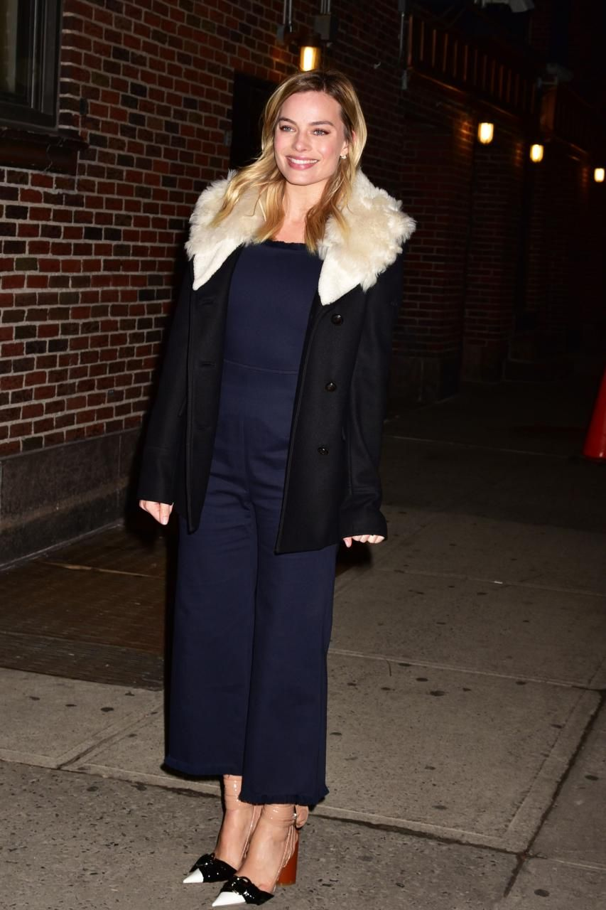 Margot Robbie wearing Christian Dior Colorblock Pumps, Jennifer Fisher Curved Flat Plate Earrings, Jennifer Fisher Curved Loop Earrings and Altuzarra Connecticut Shearling Jacket