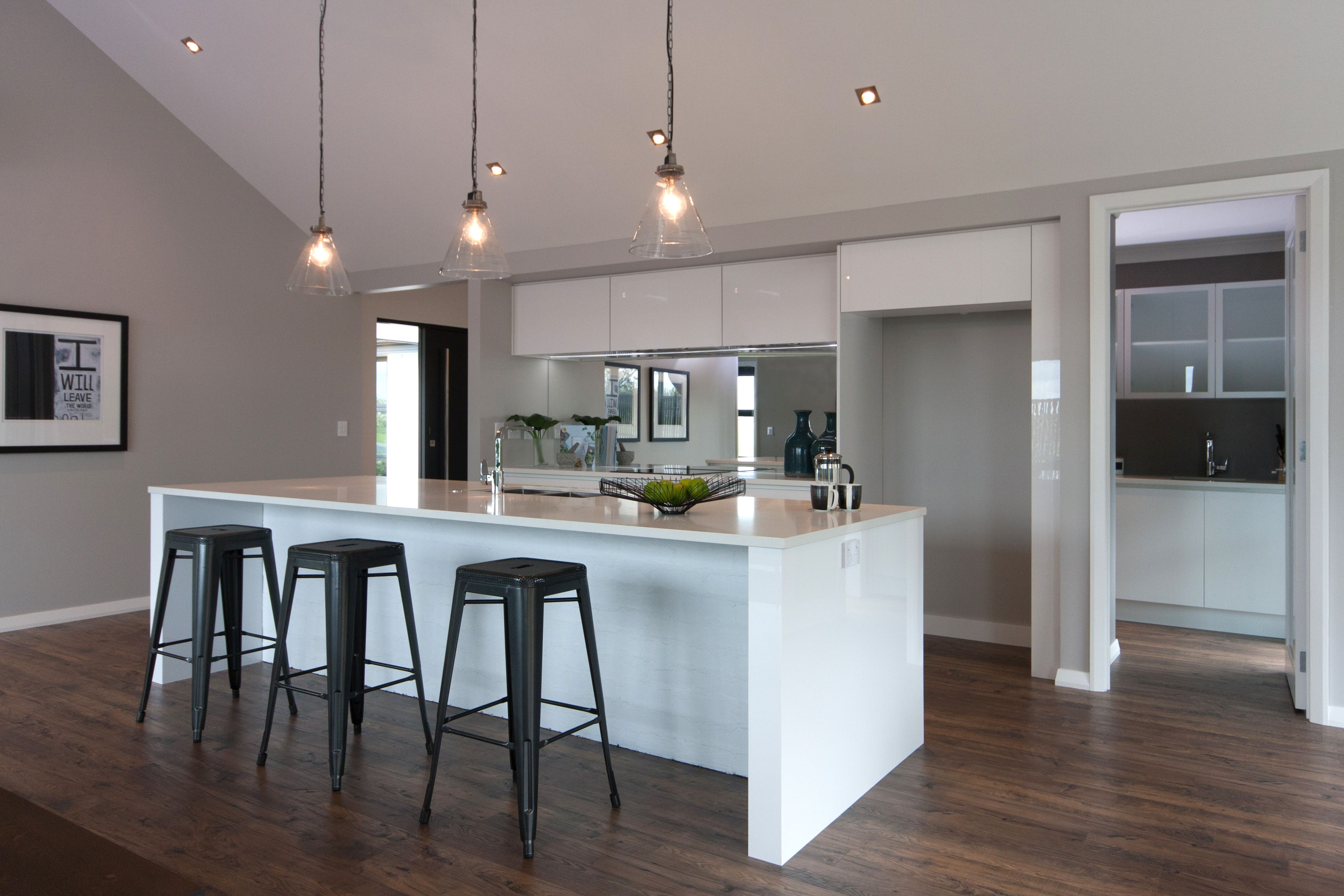The Kitchen In Our Hamilton Showhome Featuring A Mirrored Splash Back And Scullery Along The