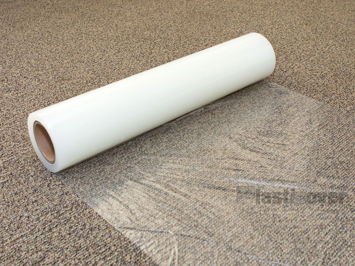 Carpet Plastic Carpet On The Floor Is Being Rolled From What Is Carpet Protector