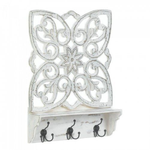 This wall accent does it all: display, organize, and decorate! It's made from mango wood and features a beautiful cutout floral inspired pattern on top. The display shelf below is perfect for showing