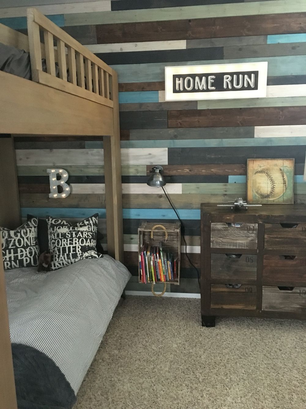 Love the wood planked wall and vintage sports themed boys room