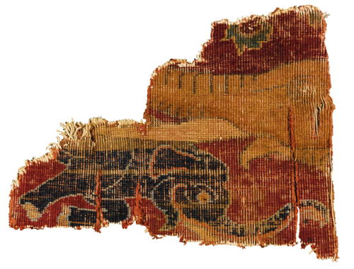 A rare Mughal carpet fragment with elephant mother and calf, North India, late 16th/17th century; another fragment with floral spray, 17th century
