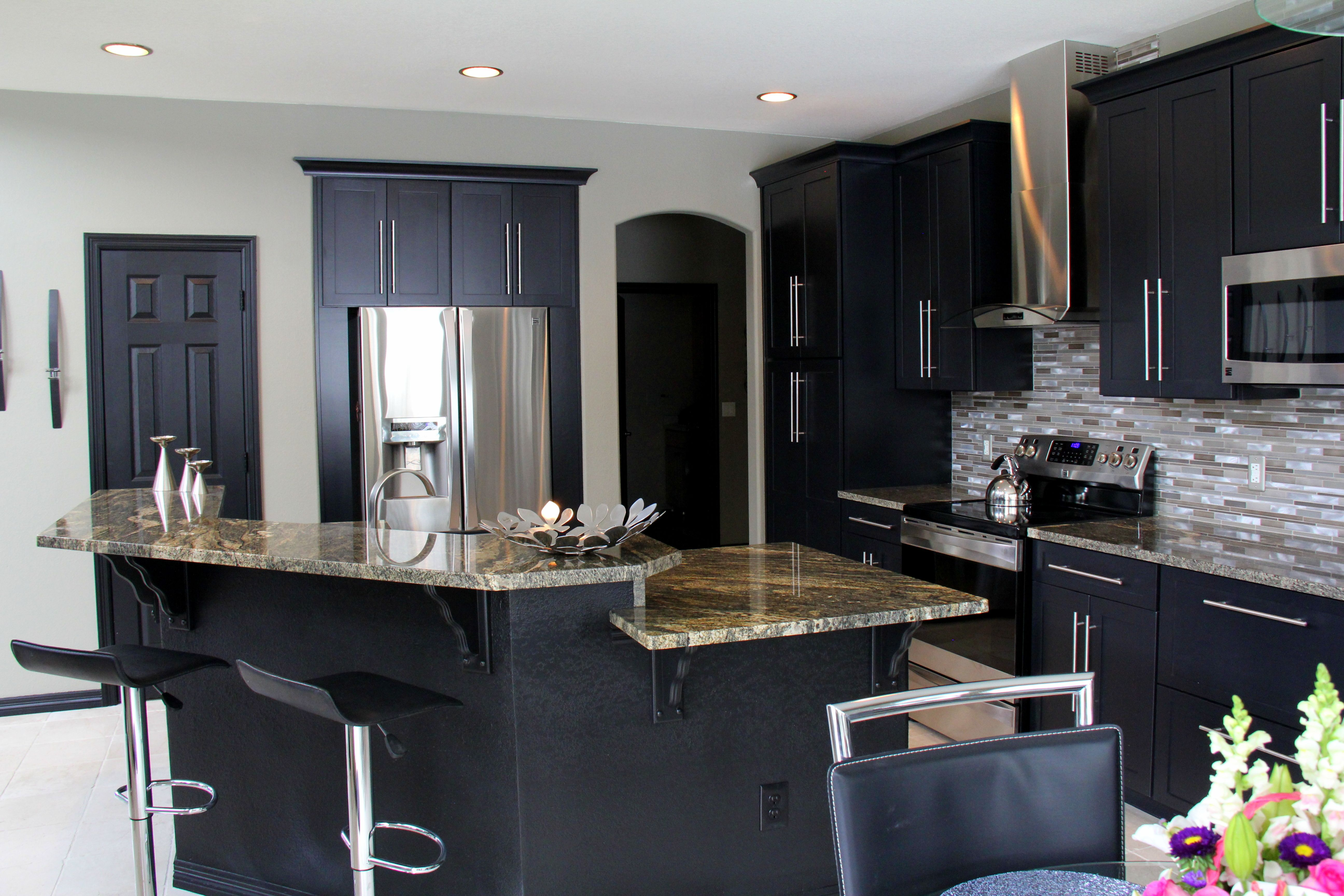 This dual-level kitchen island allows for ample counter space for ...