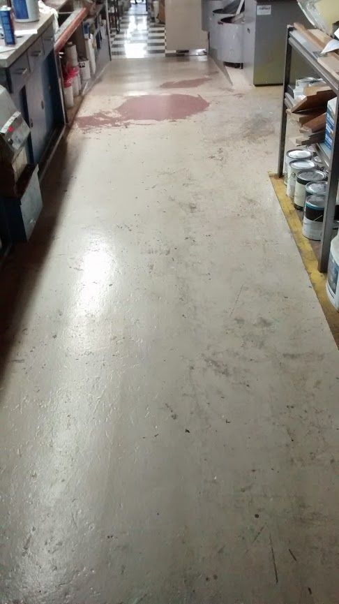This is one of 3 before pictures. The mixing area was painted 2 years ago with PPG's Break-Through. It's worn very well but paint spills and such have taken it's toll and it's time to repaint. This time we're using California Paint Tuff-On Floor Epoxy just to see how it compares.
