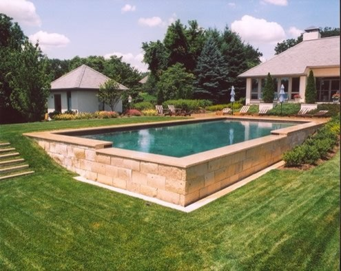 above ground pool next to retaining wall on steep slope ...