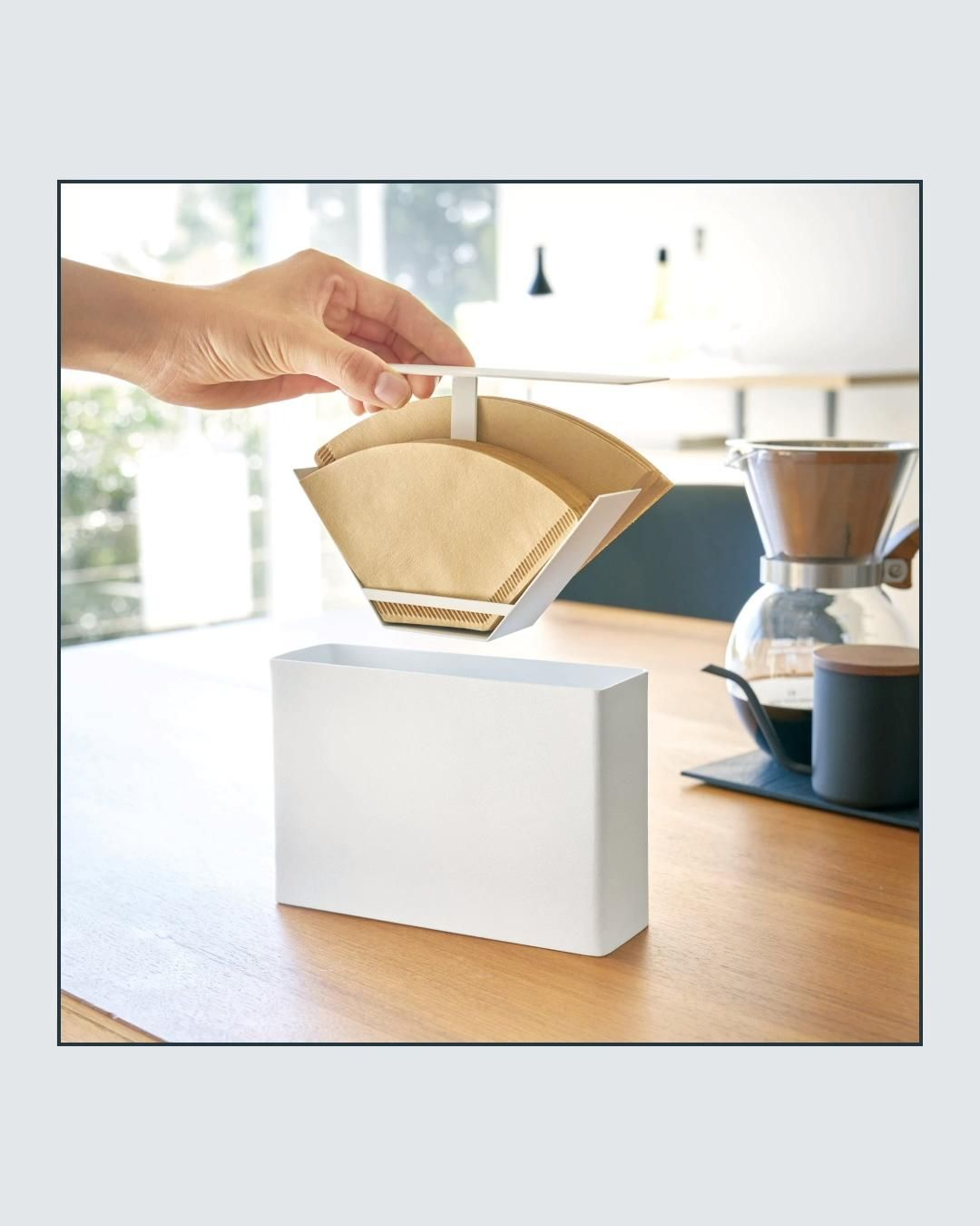 Bring a little modern sophistication to your mornings. This attractive paper coffee filter keeps them dust free and easily accessible on your countertop or cabinet. Holds #1 and #2 filters.