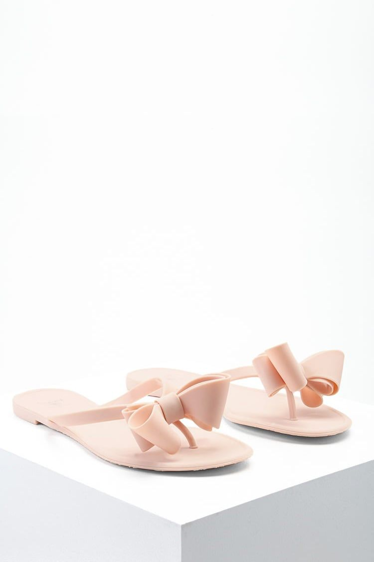 d5e22d6cc390ef A pair of jelly sandals by Dizzy™ featuring a large bow in the front and a  flip-flop design.