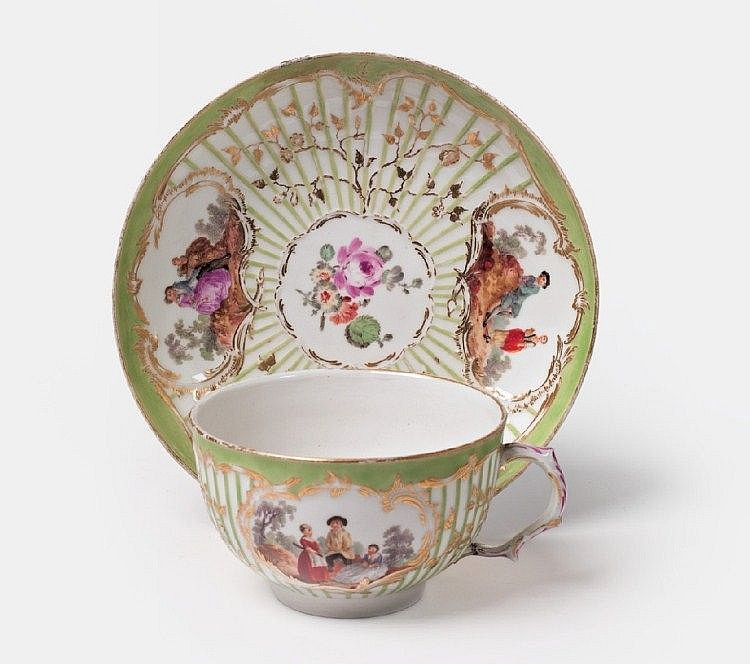 A KPM porcelain teacup with scenes after Watteau.