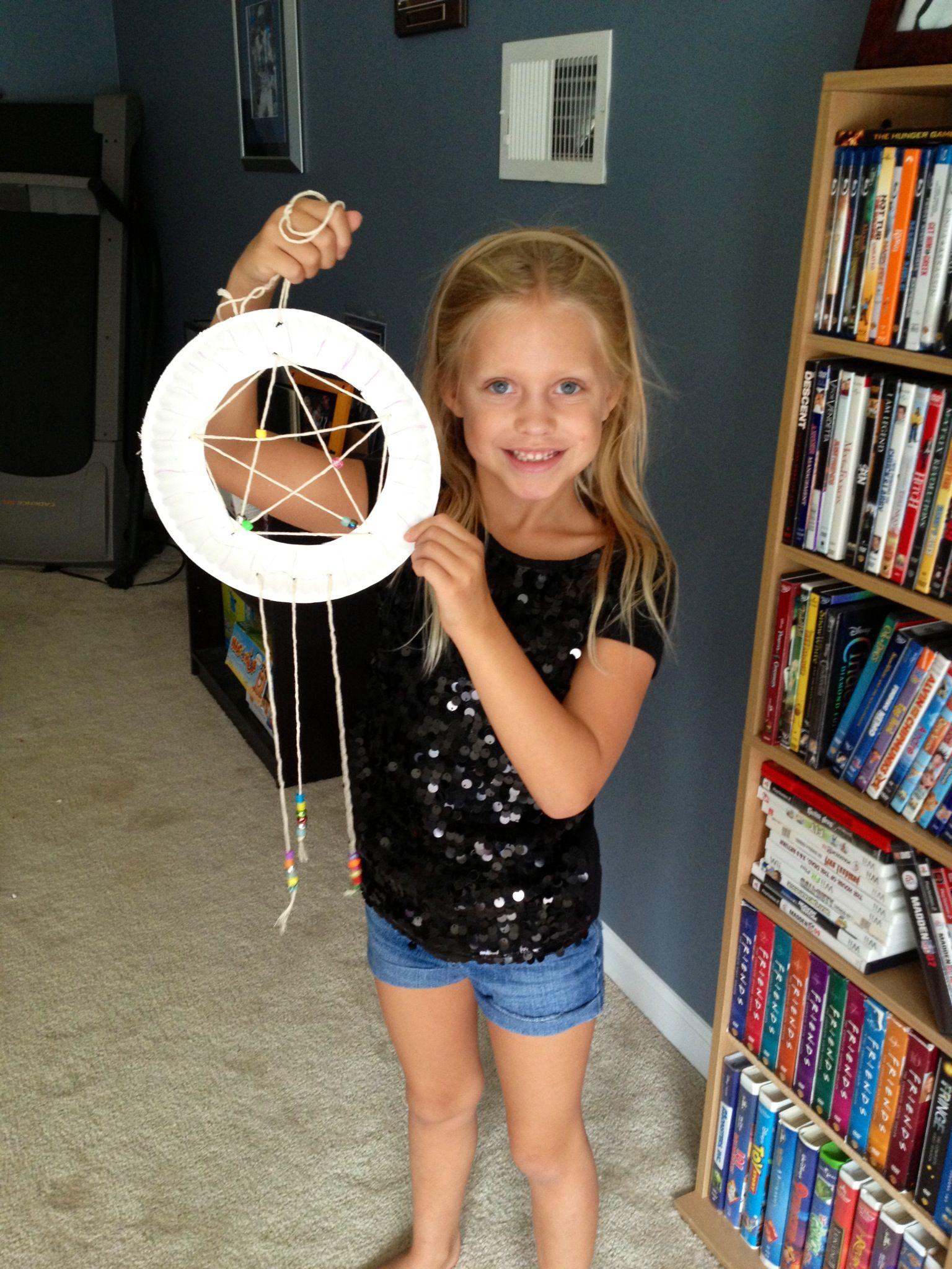 Made dreamcatchers from paper plates