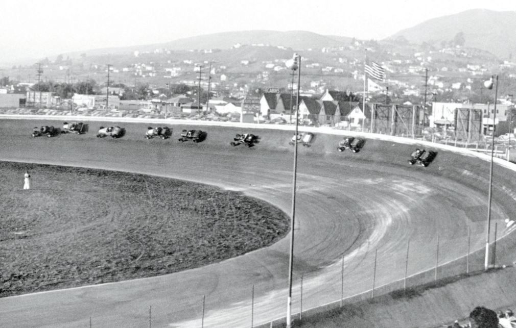 Cars heading out of Turn 2 at Oakland Stadium Speedway (5
