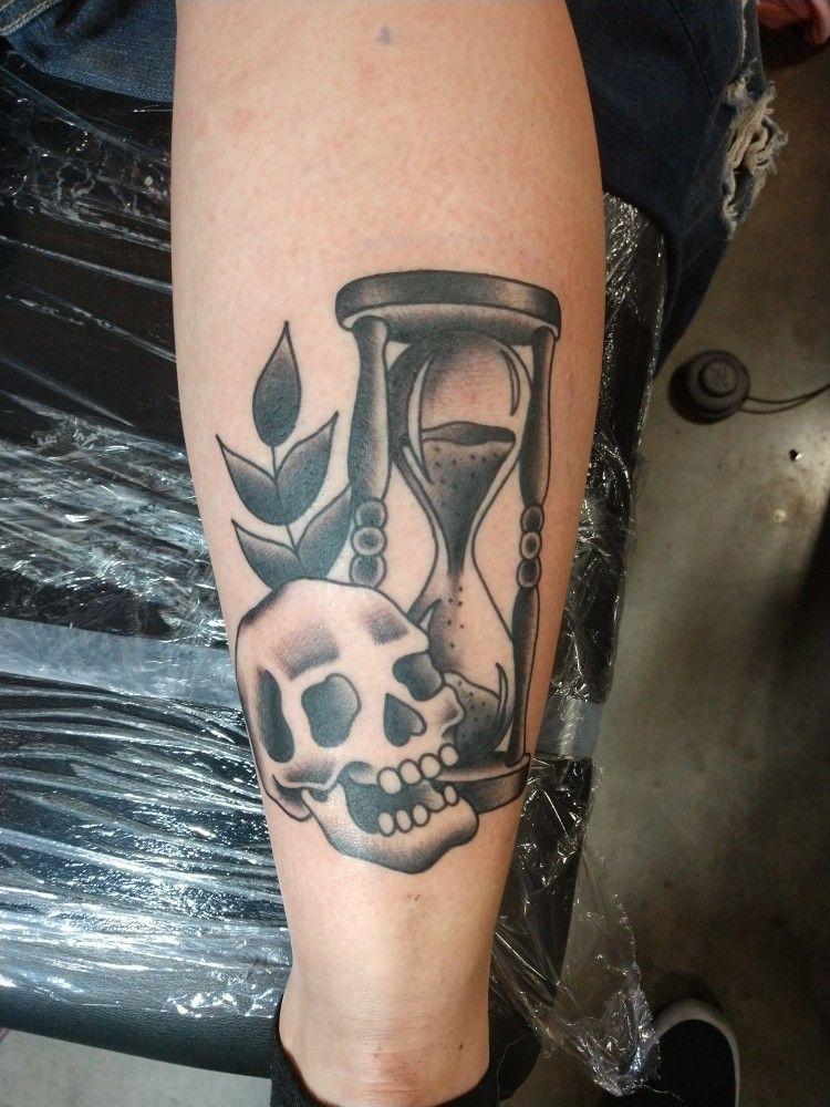 Hourglass and skull tattoo on calf star of texas tattoo