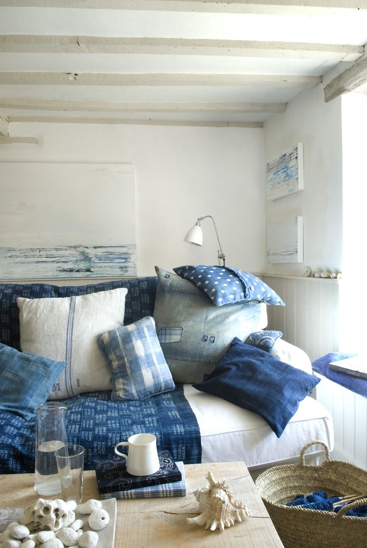 cozy beach cottage living room vibes with indigo dyed blankets and pillows