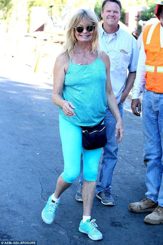 Goldie Hawn, 70, goes braless in blue figure-hugging workout gear