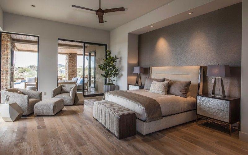 Large trendy master medium tone wood floor and brown floor bedroom design with gray walls