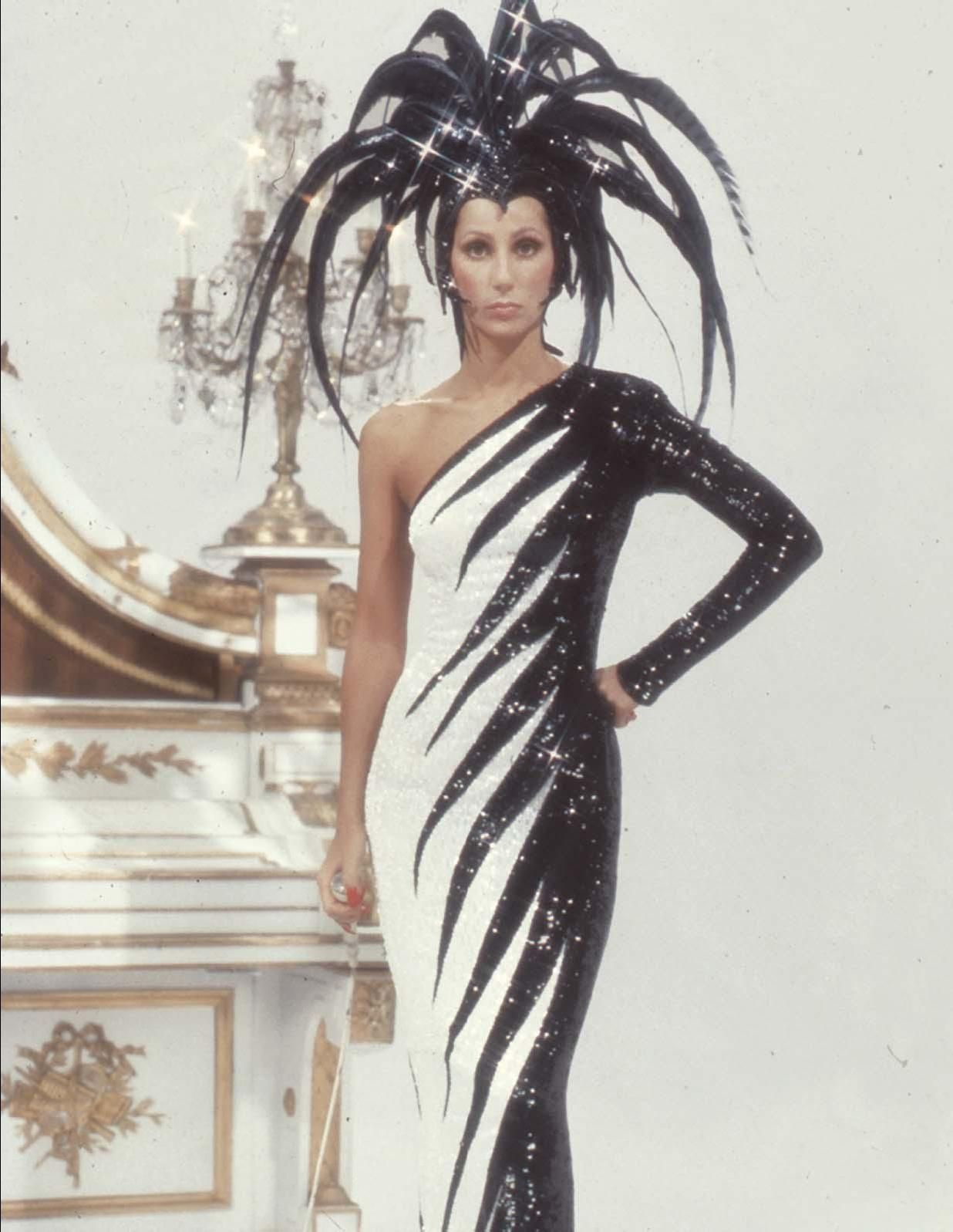Cher Circa 1970's in Bob Mackie. Nicknamed Electric Feathers for the Mego Cher doll version of the same outfit.