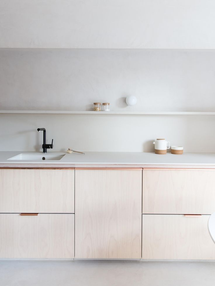 We're off to the sunny city of Madrid to tour a soft and subdued home by Plantea Studio, leaving minimalism's cold connotations at the door.