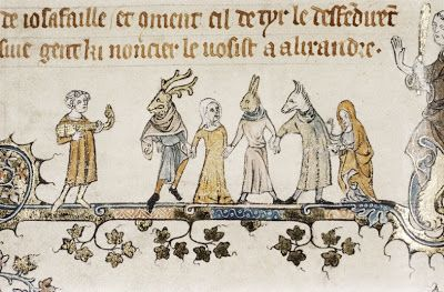 Medieval Christmas Traditions:  Actors wearing full facial masks as part of a mumming (play).  This is from a manuscript created in 1344 for the court of Edward III.  I just realised there's a monk stood behind them all looking quite threatening!  Larger picture at source.
