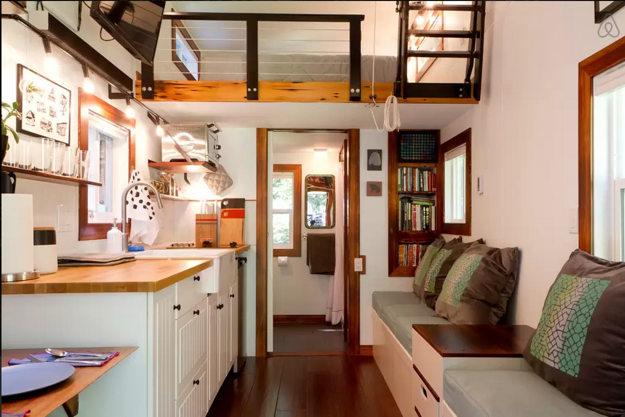 This tidy tiny home actually has room for you and a guest - Tiny house living room ...