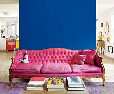 The sofa...the violet red print, the slight slouch which suggests ...