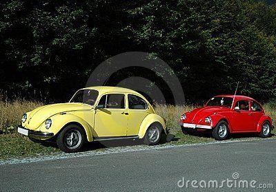 Yellow volkswagen Beetle 1302 and red beetle 1300.