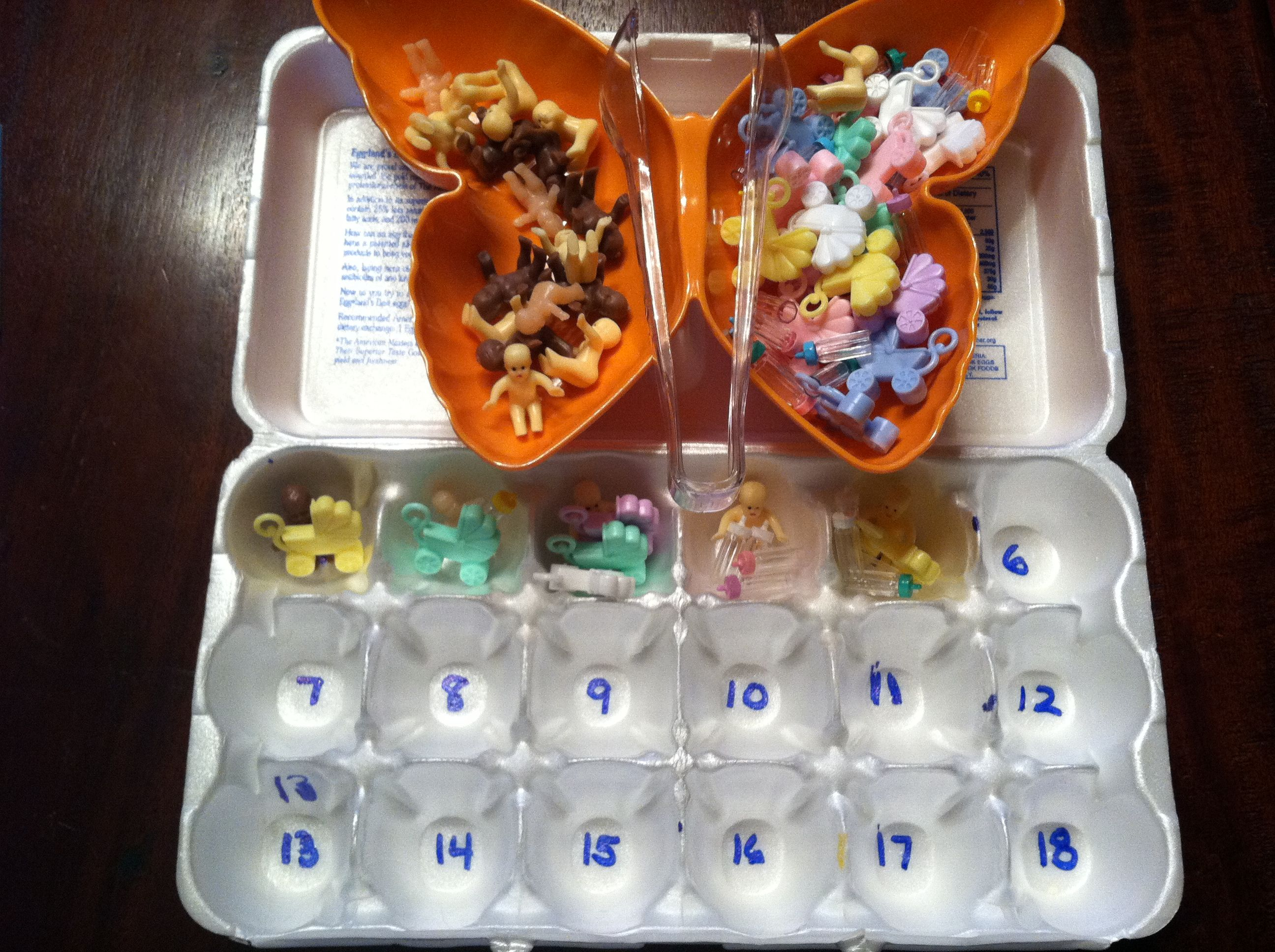 """Babysitter Counting Game:  One dollar for bag of cake decorating babies from bakery, dollar store baby shower decor tiny bottles & carriages.  """"Babysitter"""" puts baby in each numbered section then decides what baby needs and adds in appropriate amount to match number.  My daughter loves this activity!  Can use with tongs for small motor skills practice."""