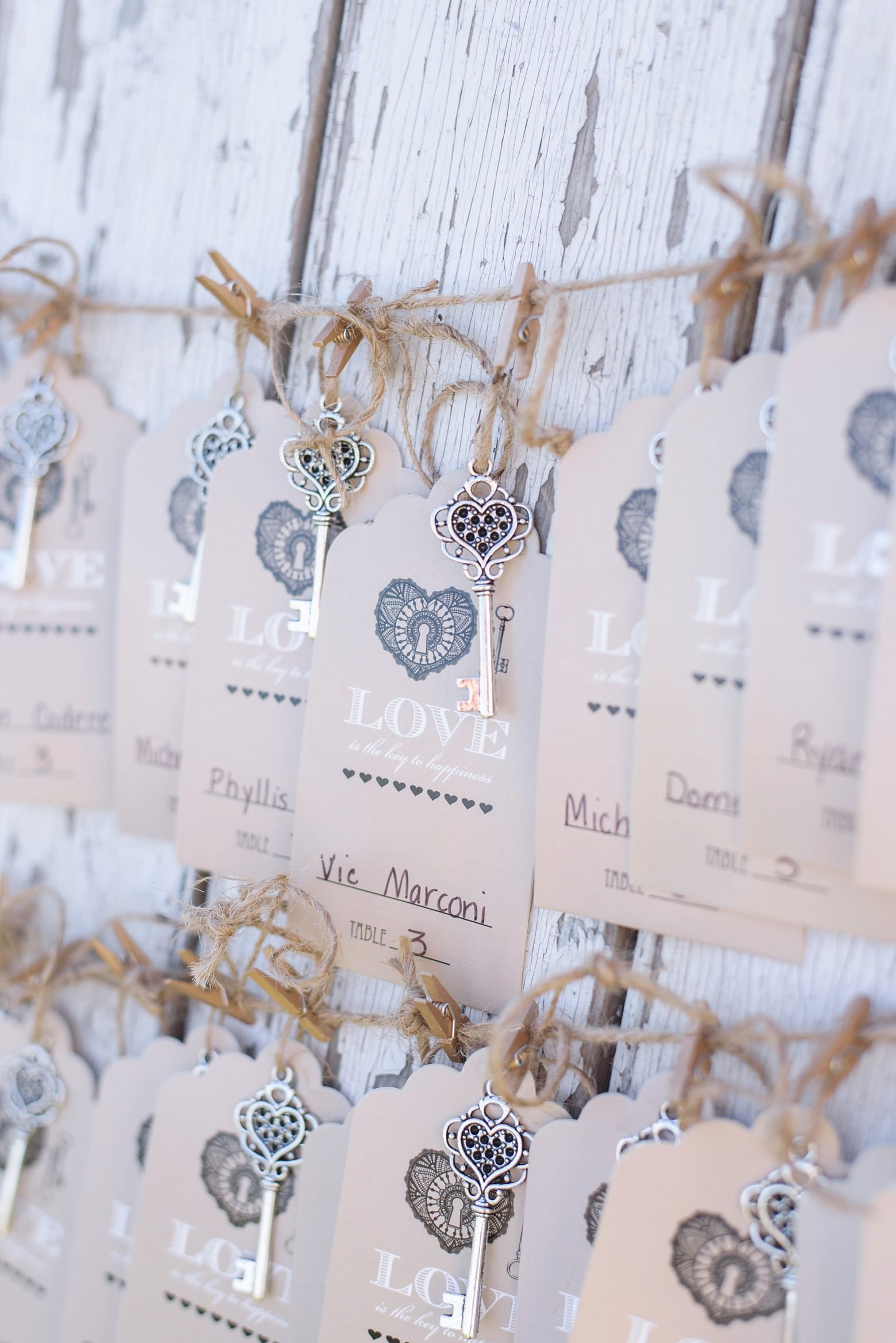 Barrington Hill Farm Wedding Key escort cards on barn door Sarah