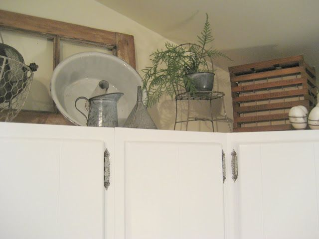 Decorating above the kitchen cabinets w/ antiques ... on decorating tips above kitchen cabinets, wasted space above kitchen cabinets, interior decorating above kitchen cabinets,