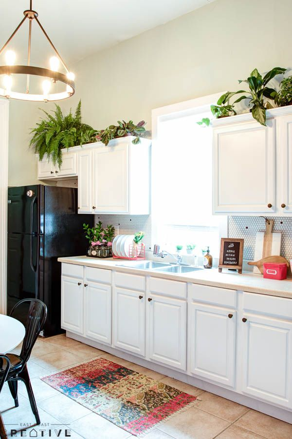 Re-painting cabinets is an easy and inexpensive way to ...