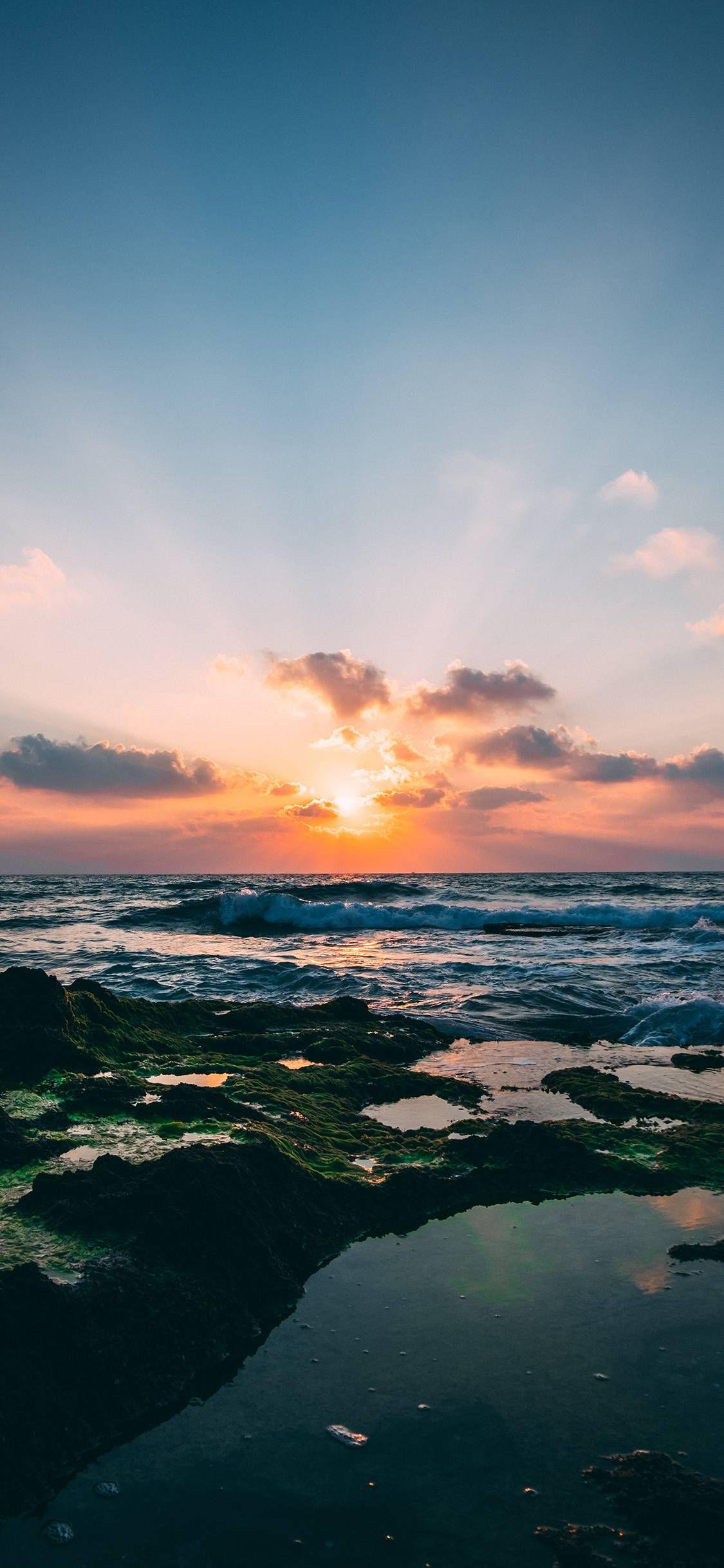 Ocean wave of sea of sunshine of the setting sun