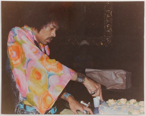 Jimi cutting his birthday cake - Nov 27, 1968