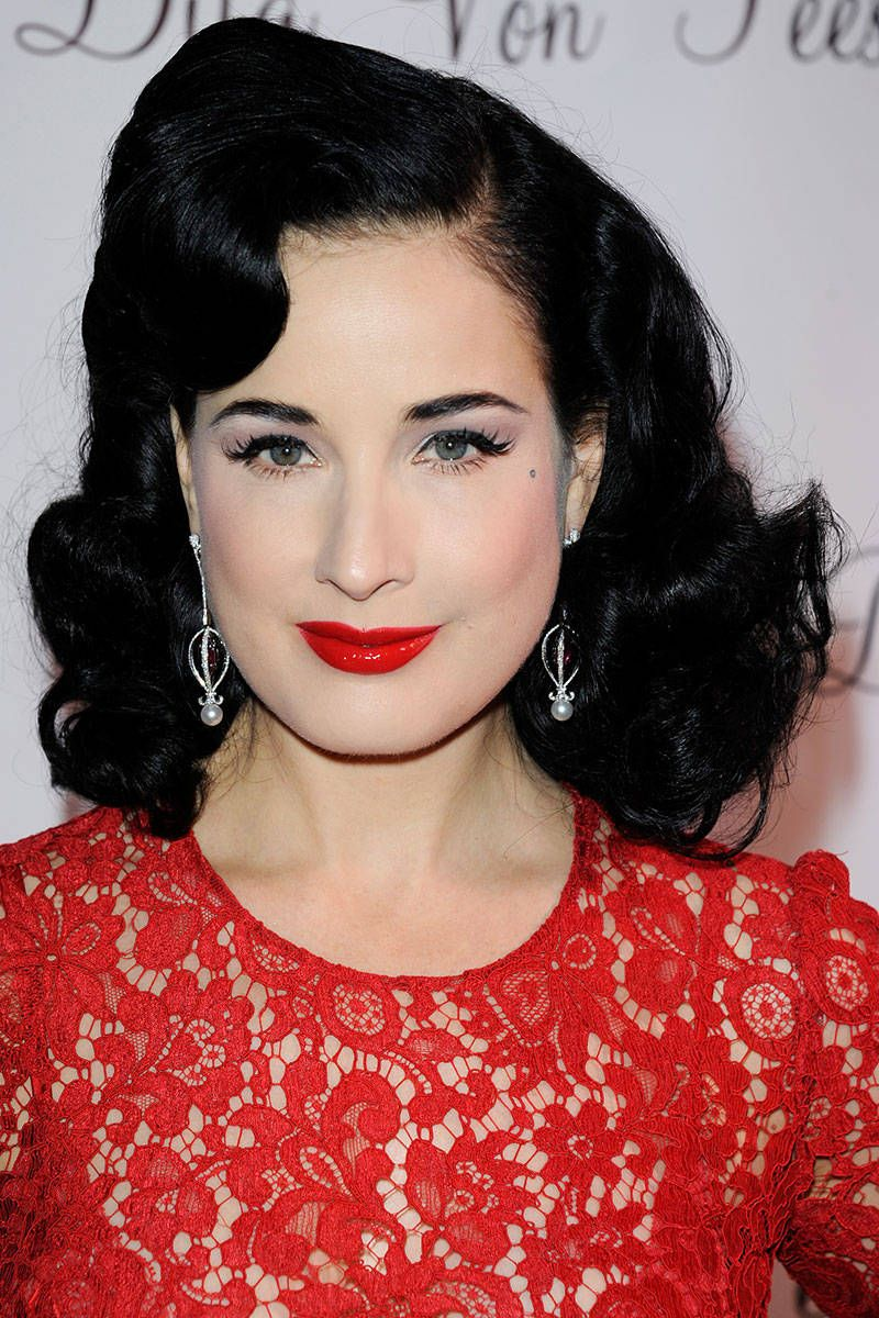 """Dita Von Teese is pinup beauty personified. It's no secret that retro weddings have experienced an uptick in popularity, and it doesn't get more vintage than this look. """"It's classic, elegant, and very ladylike,"""" said director of makeup artistry for M.A.C Gregory Alt, who works with Von Teese. """"Anytime someone has red lipstick on, it speaks to glamour and sophistication. This would be a beautiful look for an upscale or black-tie-inspired wedding."""" To get her Old-Hollywood beauty, Alt…"""