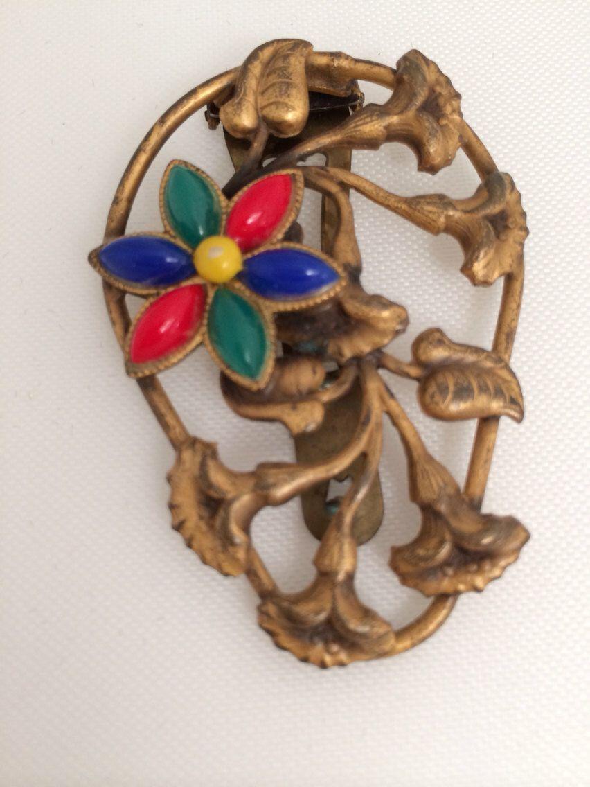 A personal favorite from my Etsy shop https://www.etsy.com/listing/240699336/antique-art-nouveau-dress-clip-brass
