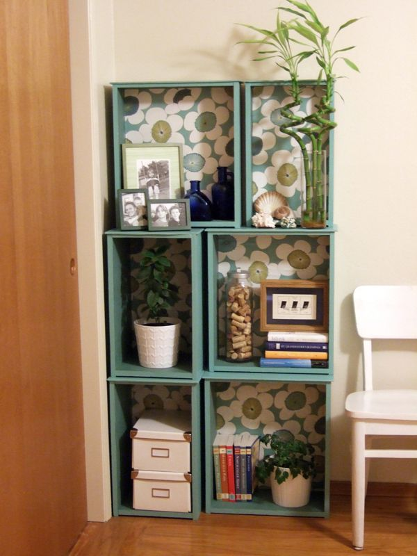 Old drawers into painted, wallpaper backed shelves. LOVE!