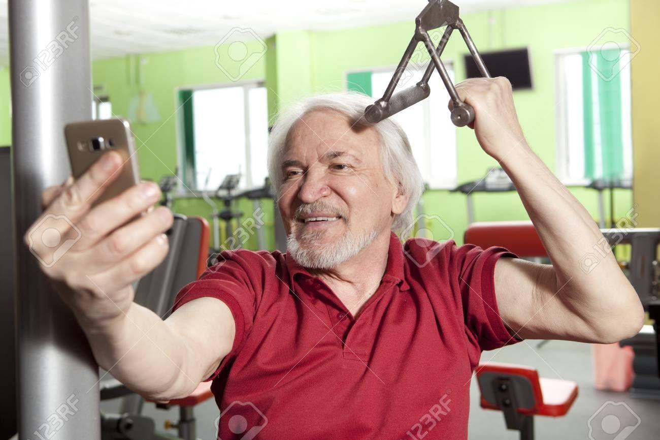 Elderly man taking a selfie with smartphone in fitness center , #AFFILIATE, #selfie, #man, #Elderly,...
