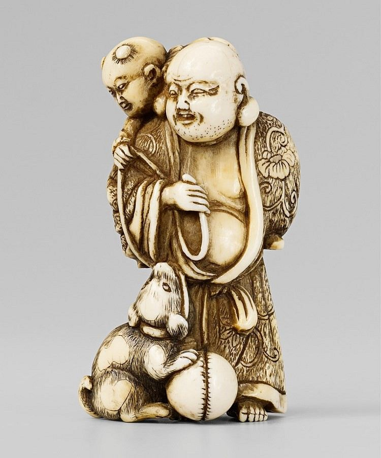 An ivory netsuke of Hotei with a karako and a dog. Early 19th century