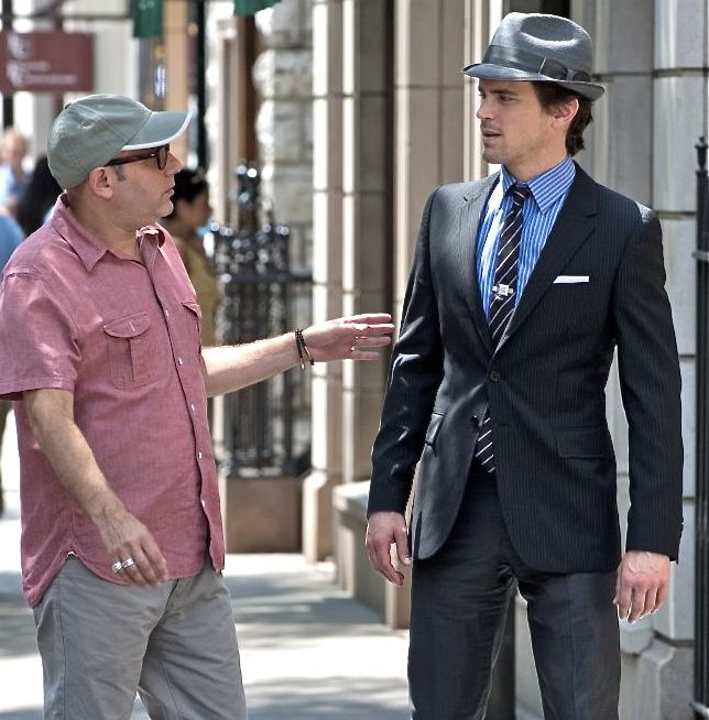 Neal Caffrey in a straw fedora by J. Hat Center, a Paul Smith blazer and  trousers, and a Thomas Pink shirt and tie.