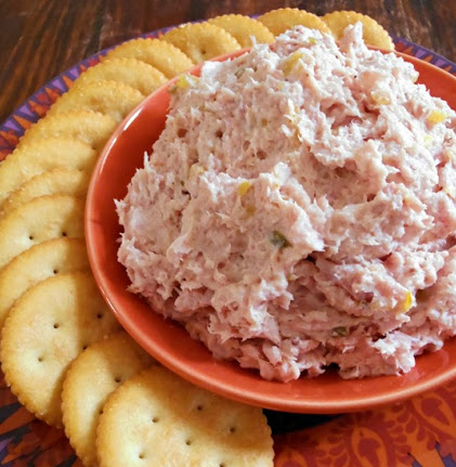 "Old-Fashioned Ham Salad. 2 cups ham, fat trimmed off and diced;½ cup miracle whip;¼ cup mayo;2 teaspoons dried onion flakes;1 teaspoon stone ground mustard;1 tablespoon sweet pickle relish. Dice the ham into small 1/2"" cubes.   Add all of the remaining ingredients except for the relish to a food processor and pulse until chunky. (You want it to be smooth enough to spread on crackers, but not so smooth that it becomes a paste. Check every few pulses and watch closely to get desired…"