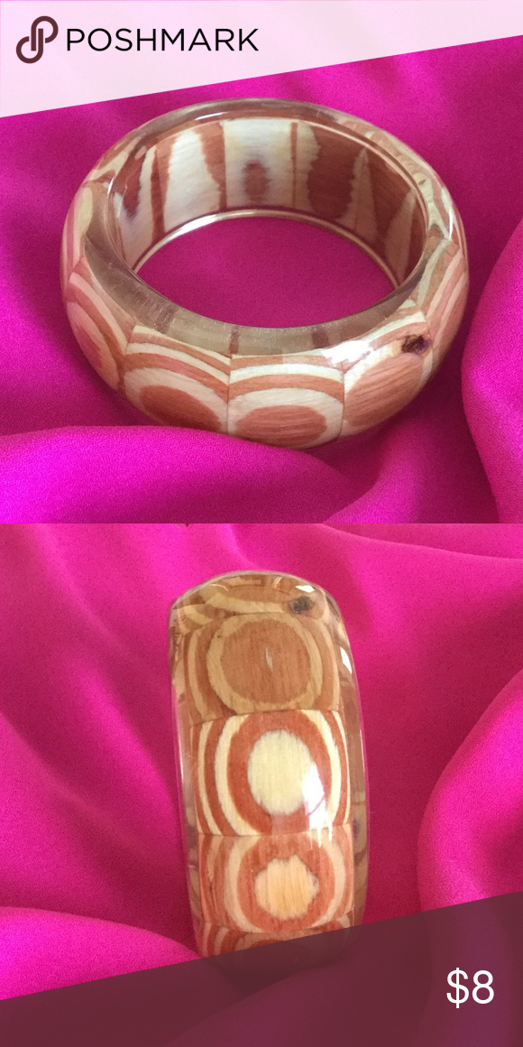 """Bracelet Beautiful bracelet clear/wooden design, purchased from a boutique with little wear. Inside opening measures just over 2.5"""" and total width is approx 3"""" Jewelry Bracelets"""
