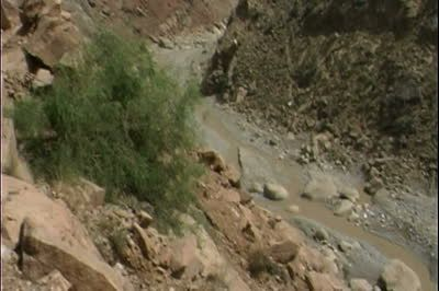 SD stock footage clip: View down rock to dirt road in desolate mountain pass in Bannu District, Pakistan.