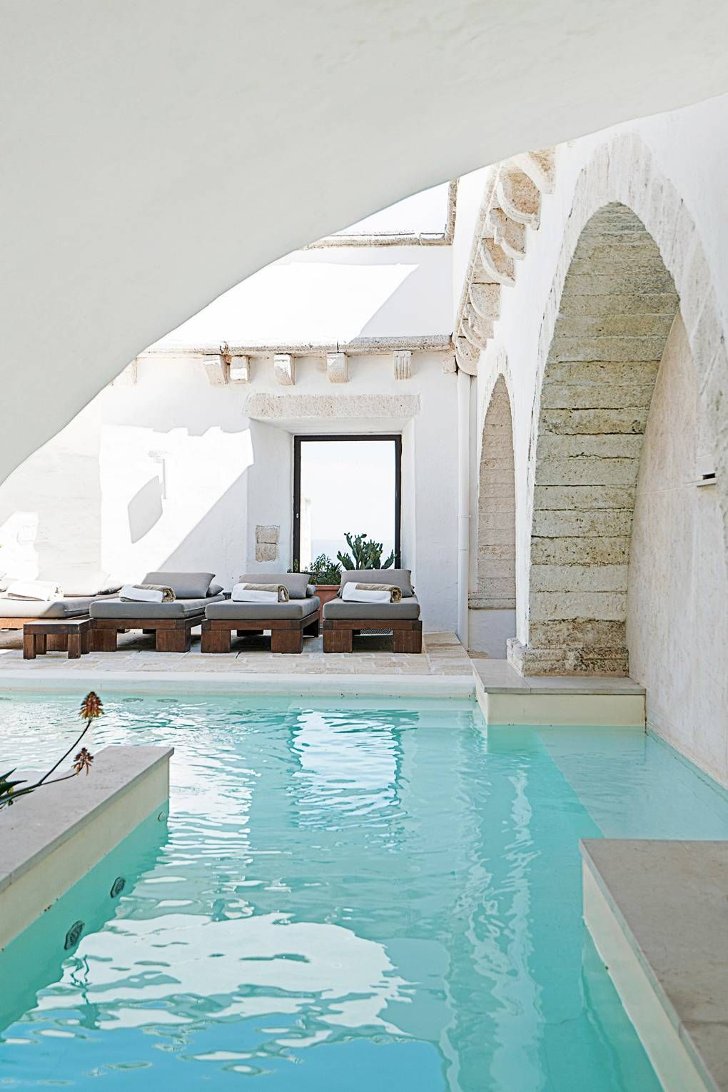 Inside some of the coolest #cave hotels, including this white-washed stone #hotel in Ostuni in Puglia, southern #Italy.