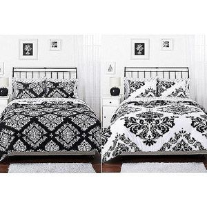 reversible black and white comforters perfect for the girls' room: pair with bright sheets in individual colors. Classic Noir Reversible Comforter Set