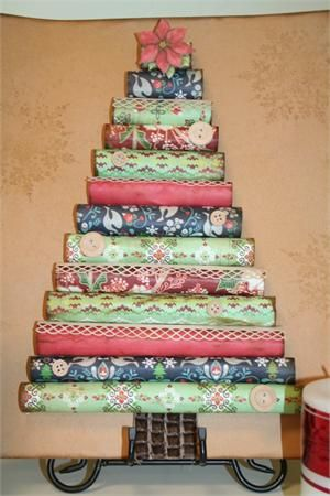 Create a Christmas tree from rolled wrapping paper, wall paper or scrapbook paper