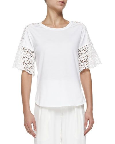 Add a touch of femininity to any look with this Chloe Short-Sleeve Ring-Lace Tee. For more Chloe, visit http://balharbourshops.com/