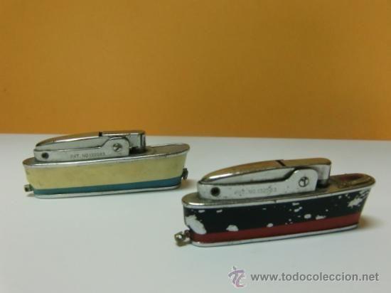 Dos mecheros forma de barco. SAROME CRUISER