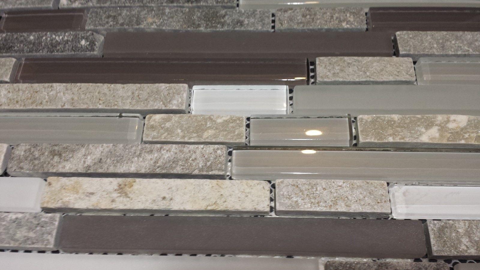 Gray quartz stone mosaic with light gray glass tile kitchen